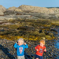 Twin boys play on East Gosling Island in Casco Bay, Harpswell, Maine.