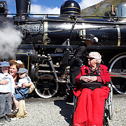 Annette Bryce, (right) mother of Kingston Flyer owner David Bryce with family members Rachel Reed (left) and her sons Albert, 3, and Frederick, 22 months  in front of the Kingston Flyer vintage steam train at Saturday's relaunch of the historic locomotives at Fairlight near Queenstown, Central Otago, New Zealand, 29th October 2011. Photo Tim Clayton...