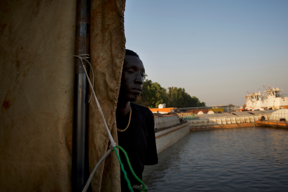 A young South Sudanese, recently arrived in Juba after years living in Khartoum, found himself stranded around Juba port awaiting aid and relocation by International NGOs.