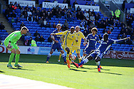 Nadjim Abdou of Millwall © has a shot blocked by Cardiff city's Bruno Ecuele-Manga ®. Skybet football league championship, Cardiff city v Millwall at the Cardiff city stadium in Cardiff, South Wales on Saturday 18th April 2015<br /> pic by Andrew Orchard, Andrew Orchard sports photography.