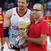 Turkish players Hidayet TURKOGLU (L) celebrate with the Istanbul Cup championship trophy during their Istanbul CUP 2011match played Montenegro between Turkey at Abdi Ipekci Arena in Istanbul, Turkey on 25 August 2011. Photo by TURKPIX