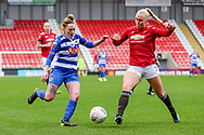 Readingmidfielder Rachel Rowe (23) is tackled by Manchester United defender Maria Thorisdottir (3) during the FA Women's Super League match between Manchester United Women and Reading LFC at Leigh Sports Village, Leigh, United Kingdom on 7 February 2021.