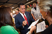 Gov. Mitt Romney greets supporters during a brief stop September 12, 2011 in North Charleston, South Carolina.  Romney toured a new Boeing facility in Charleston and then accepted the endorsement of Gov. Tim Pawlenty during a short visit to the city.