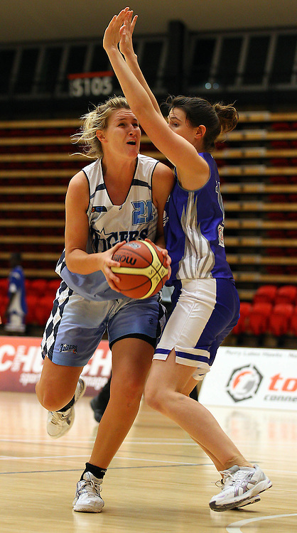 PERTH, AUSTRALIA - JULY 16: Emma Lobb of the Tigers drives to the basket against Chelsea Boyanich of the Hawks during the week 18 SBL game between the Perry Lakes Hawks and the Willetton TIgers at The State Basketball Center on July 16, 2011 in Perth, Australia.  (Photo by Paul Kane/All Sports Photography)
