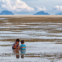 Two boys playing on a beach in Koh Yao Yai.