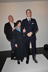 REG GADNEY and FAYE MASCHLER with a statue of Prince William at a private view of 'Engagement' an exhibition of new works by Jennifer Rubell held at the Stephen Friedman Gallery, 25-28 Old Burlington Street, London on 7th February 2011.