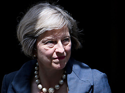 © Licensed to London News Pictures. 26/07/2016. London, UK. British prime minister THERESA MAY leaves 10 Downing Street in London to greet Taoiseach Enda Kenny (not pictured) . The pair are expected to discuss impact of Britian's recent vote for Brexit. Photo credit: Ben Cawthra/LNP