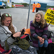Anti-fracking  activists and protesters outside the gates of Quadrilla's fracking site June 31st, Lancashire, United Kingdom. The struggle against fracking in Lancashire has been going on for years. The fracking company Quadrilla is finally ready to bring in a drill tower to start drilling and anti-frackinhg activists are waiting in front of the gates to block the equipment getting in.