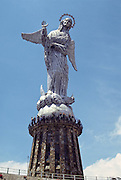 """La Virgen de Quito, on Panecillo hill, is an aluminum statue of the winged virgin (45 meters tall), inspired and enlarged from Bernardo de Lagarda's 1734 sculpture on display on the main altar in San Francisco Church, Quito, Ecuador, South America. This madonna was created in 1976 by Spanish artist Agustín de la Herrán Matorras. The virgin stands on top of a globe and is stepping on a snake. The wings are unusual in the tradition of madonna icons. Seen to the south of downtown Quito, the Panecillo hill looks like a """"small bread roll"""" (its Spanish translation) and stands at about 3000m (9840 feet). Before the Spanish arrived, the Incas worship the sun on Shungoloma, or Hill of the Heart (present-day Panecillo).  Later, from 1812 to 1815, the Spanish constructed a fortress on the hill to control people below. Visit from Old Town via inexpensive taxi. See panoramic 360° views of Quito from here, best early in the morning (around 10:00 am), before the clouds form on nearby mountains. On a clear day, see Cotopaxi in the distance.  UNESCO honored City of Quito as a World Heritage Site in 1978. Quito was founded in 1534 on the ruins of an Inca city. Despite the 1917 earthquake, the city has the best-preserved, least altered historic center in Latin America."""