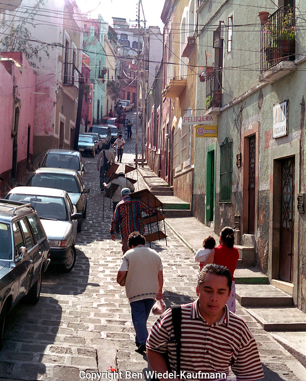 Cobbled street scene in Mexican town.