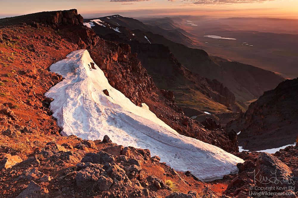 The east face of Steens Mountain in southeast Oregon is turned golden at sunrise. Steens Mountain is a roughly 30-mile (48-kilometer) long block mountain that rises a mile above the Alvord Desert. Massive internal pressure forced the ridge upward; glaciers carved dramatic gorges on the western face. Steens Mountain is the largest block-fault mountain in the Great Basin of Oregon and Nevada.