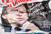 crumpled newspaper with portrait of French president Emmanuel Macron