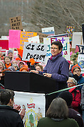 Augusta, Maine, USA. 21st Jan, 2017.  Eliza Townsend, Executive Director of the Maine Women's Lobby, addresses the Women's March on Maine rally in front of the Maine State Capitol. The March on Maine is a sister rally to the Women's March on Washington.