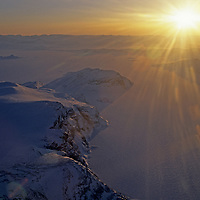 BAFFIN ISLAND, Nunavut, Canada. Sunset on fjord & mountains south of Clyde River hamlet.