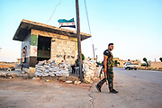 Members of the Free Syria Army stand guard at an outpost on the outskirt of Marea, near Aleppo in northern Syria, on Wednesday, June 27, 2012. International envoy Kofi Annan has proposed setting up a Syrian transitional government that could include followers of President Bashar al-Assad and opposition members in a bid to end the country's war, diplomats said. (Photo by Vudi Xhymshiti)