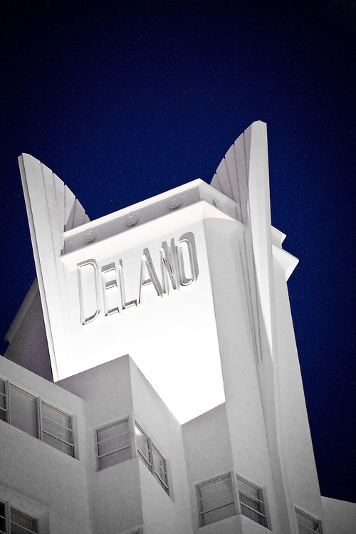 The illuminated, winged tower of the Art Deco-style Delano Hotel at night on Miami Beach's Collins Avenue. It was designed  by architect Robert Swartberg in 1947.