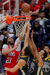 May 6, 2018 - New Orleans, LA, U.S. - NEW ORLEANS, LA - MAY 06:  New Orleans Pelicans forward Anthony Davis (23) taps the ball into the basket against Golden State Warriors guard Klay Thompson (11) during game 4 of the NBA Western Conference Semifinals at Smoothie King Center in New Orleans, LA on May 06, 2018.  (Photo by Stephen Lew/Icon Sportswire) (Credit Image: © Stephen Lew/Icon SMI via ZUMA Press)