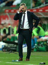Poland manager Jerzy Brzeczek puts his head in his hands during the International Friendly at the Stadion Miejski, Wroclaw.