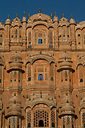 The Hawa Mahal, known as the Palace of the Winds. Built in 1799 by Maharaja Sawai Pratap Singh in the form of the crown of Krishna, the Hindu god. It has 953 small windows called jharokhas that are decorated with intricate latticework intended to allow the women of the court to see outside without being seen, Jaipur, India