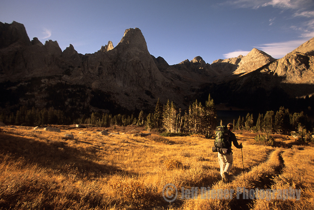 A young man hikes through the Cirque of the Towers in the Wind River Mountains, Wyoming.