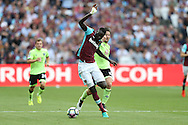 Cheikhou Kouyate of West Ham United is pulled back by Harry Arter of AFC Bournemouth for which Referee Craig Pawson gives Harry Arter of AFC Bournemouth a second yellow and red card and is sent off. Premier league match, West Ham Utd v AFC Bournemouth at the London Stadium, Queen Elizabeth Olympic Park in London on Sunday 21st August 2016.<br /> pic by John Patrick Fletcher, Andrew Orchard sports photography.