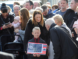 A young boy in the crowd outside the Aberfan Memorial Garden in Wales after meeting the Prince of Wales on the 50th anniversary of the tragedy.