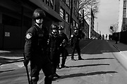 01212018 - Knoxville, Tennessee, USA: Police guard the entrance to a garage where members of the Traditionalist Worker Party, a neo-Nazi white nationalist group, were escorted to a parking garage by police after protesting against the Women's March, Sunday, January 21, 2018 in Knoxville, Tenn.