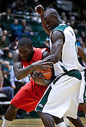 SHOT 2/23/10 9:14:03 PM - Colorado State's Mame Bocar Ba tries to strip the ball from New Mexico's Will Brown under the basket during the first half of their regular season Mountain West Conference game at Moby Arena in Fort Collins, Co. New Mexico survived a tight game winning 72-66. (Photo by Marc Piscotty / © 2010)