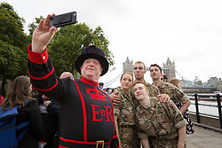 © Licensed to London News Pictures. 07/09/2017. LONDON, UK.  A Beefeater (Yemon Warder) from the Tower of London takes a selfie with dancers from the British Army after a photocall. The British Army in conjunction with the Rosie Kay Dance Company performed an extract of 5 SOLDIERS: The Body is the Frontline, at Tower Wharf in the Tower of London to celebrate the work's return to London.  Photo credit: Vickie Flores/LNP