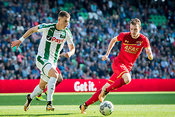 (L-R) Adjin Hrustic of FC Groningen, Thomas Ouwejan of AZ during the Dutch Eredivisie match between FC Groningen and AZ Alkmaar at Noordlease stadium on October 15, 2017 in Groningen, The Netherlands