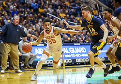 Feb 9, 2019; Morgantown, WV, USA; Texas Longhorns guard Elijah Mitrou-Long (55) drives during the first half against the West Virginia Mountaineers at WVU Coliseum. Mandatory Credit: Ben Queen-USA TODAY Sports