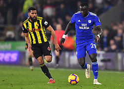 Watford's Adrian Mariappa (left) and Cardiff City's Oumar Niasse battle for the ball during the Premier League match at the Cardiff City Stadium.