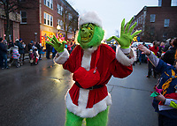 The Grinch walks down Main Street during the annual Light Up Laconia Holiday Parade on Sunday afternoon.  (Karen Bobotas/for the Laconia Daily Sun)