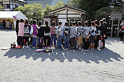 group Japanese school children posing for photo at historical site in kamakura Japan