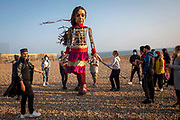 Little Amal took her first steps in the United Kingdom today when she arrived to a warm welcome from locals on the 19th of October 2021 the seafront in Folkestone, United Kingdom.  Little Amal is a 3.5 metre-tall living artwork of a young Syrian refugee child who has spent the last 3 months walking 8000 km from the boarder of Syria across Turkey, Greece, Italy, France, Switzerland, Germany, Belgium and the UK to focus attention on the urgent needs of young refugees.