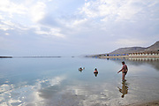 Israel, Dead Sea tourists floating in the water