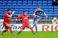 Cardiff City's Craig Noone (R) has his shot blocked by Blackburn Rover's Markus Olsson (c) and Grant Hanley (l). Skybet football league championship match, Cardiff city v Blackburn Rovers at the Cardiff city stadium in Cardiff, South Wales on Saturday 2nd Jan 2016.<br /> pic by Carl Robertson, Andrew Orchard sports photography.