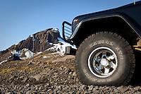 Highlands of Iceland. Close up of a Land Rover tire. Mountain Einhyrningur in background.<br /> <br /> Nærmynd af Land Rover og fjallið Einhyrningur í baksýn.