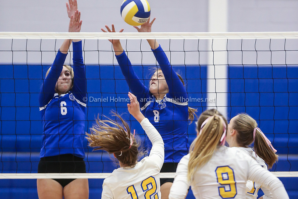 (10/10/19, WHITINSVILLE, MA) Ashland's Lilian Schiller, left, and Lauren Politica go up for the block during the the volleyball game against Whitinsville Christian at Whitinsville Christian High School on Thursday. [Daily News and Wicked Local Photo/Dan Holmes]