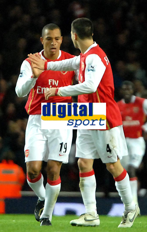 Photo: Ed Godden.<br /> Arsenal v Portsmouth. The Barclays Premiership. 16/12/2006. Arsenal's Gilberto (L) celebrates his goal with Cesc Fabregas.