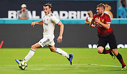 July 31, 2018 - Miami Gardens, FL, USA - Gareth Bale of Real Madrid drives toward goal as Luke Shaw of Manchester United follows on the play during International Champions Cup action at Hard Rock Stadium in Miami Gardens, Fla., on Tuesday, July 31, 2018. Manchester United won, 2-1. (Credit Image: © Jim Rassol/TNS via ZUMA Wire)