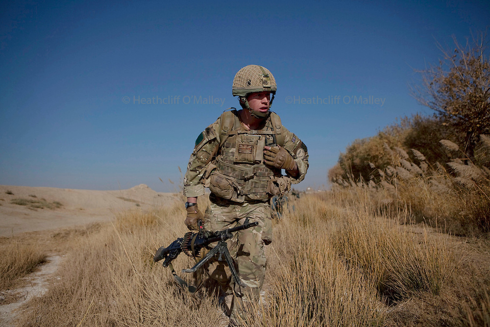 Mcc0027461 . Daily Telegraph..Cpl Jamie Law..Paratroopers from A coy, 3 Para under the command of Lt Jamie Macdonald on patrol south of their base CP Qudtrat in the northern Nad e Ali district of Helmand. ..Helmand 2 December 2010