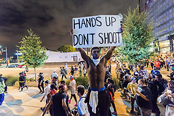 September 22, 2016 - Charlotte, North Carolina, U.S. - Protestors make their way through Uptown during a third day of protests in Charlotte. This is the third day of protests that erupted after a police officer's fatal shooting of an African-American man Tuesday afternoon and the first full day of a declared State of Emergency by the governor. (Credit Image: © Sean Meyers via ZUMA Wire)