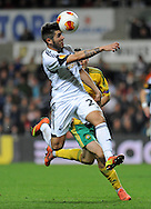 Álex Pozuelo heads the ball for Swansea City.<br /> UEFA Europa league match, Swansea city v FC Kuban Krasnodar at the Liberty Stadium in Swansea, South Wales on Thursday 24th October 2013. pic by Phil Rees, Andrew Orchard sports photography,
