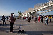 Buskers in the street playing outside the Museum of Tomorrow, in the newly regenerated port area of Rio de Janeiro.