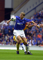 Rangers v Maribor, Champions League Qualifier, Ibrox park Glasgow.<br />Pic Ian Stewart, Wednesday August 1st, 2001<br /><br />Tore Andre Flo tries to fend off a Maribor defender