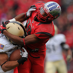 10 November 2012: Rutgers Scarlet Knights defensive back Marcus Cooper (12) wraps then loses hold of Army Black Knights defensive back Josh Jackson (14) on a punt coverage during NCAA college football action between the Rutgers Scarlet Knights and Army Black Knights at High Point Solutions Stadium in Piscataway, N.J..