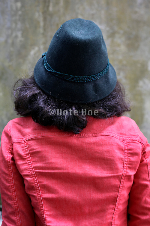 back view of female person wearing a green hat