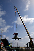 UK, Penzance - Monday, March 23, 2009: A bell is lifted by a crane on to the Isles of Scilly Steamship Company's supply vessel the Gry Maritha to be transported to St Mary's on the Isles of Scilly. (Image by Peter Horrell / http://www.peterhorrell.com)
