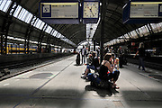 Amsterdam Central station with waiting passengers on the platform